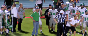 Contributed Photo/Courtesy iTalk 106.7: Thatcher head coach Sean Hinton argues the opposing player was down as an assistant coach attempts to show the officials the video stream of the game as proof.