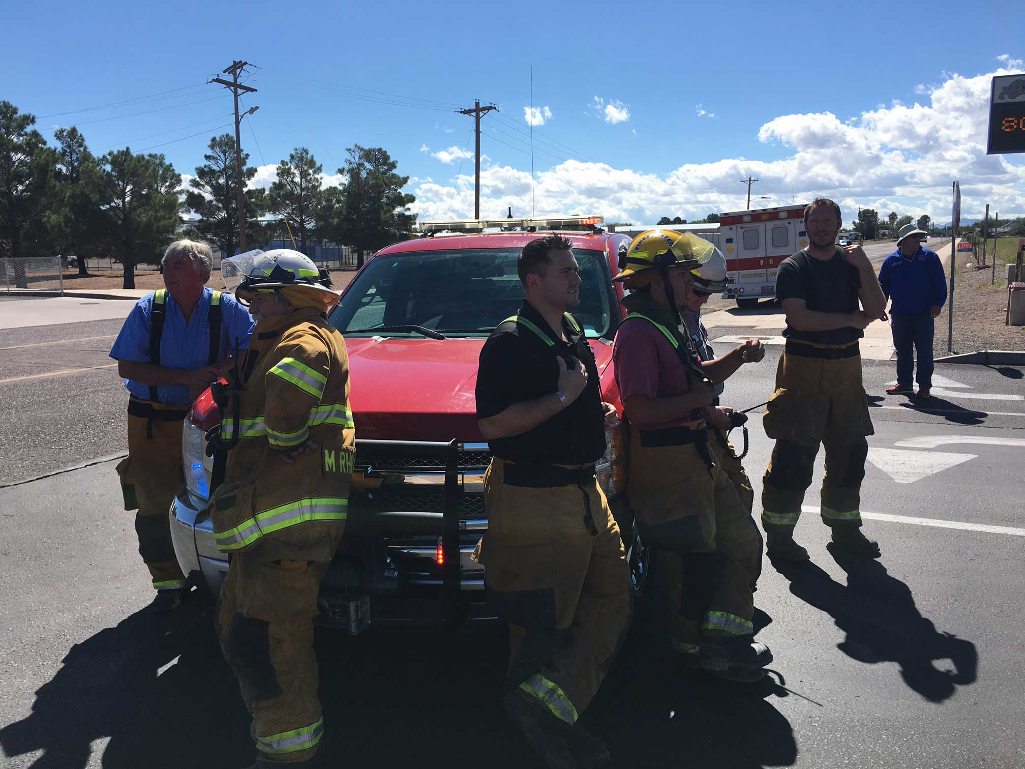 Jon Johnson Photo/Gila Valley Central: Firefighters await instruction during the Safford High School bomb threat hoax.