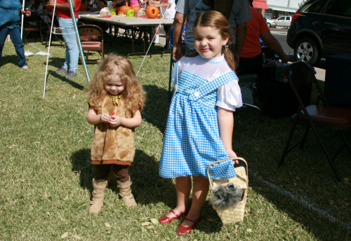 Brooke Curley Photo/ Gila Valley Central: Left to Right- Kaitlyn Cuenin is the Cowardly Lion and Lauren Cuenin is Dorothy for the Enchanted Boutique's Costume Fashion Show.