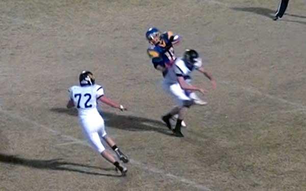 Jon Johnson Photo/Gila Valley Central: Pima's Joshua Whitaker takes a hit while punting the ball.