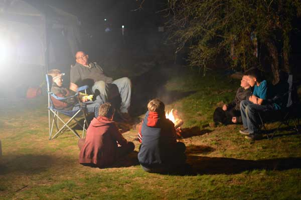 Contributed Photo: Boy Scouts settle in around a fire.