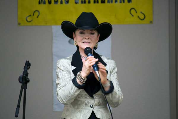 Jon Johnson Photo/Gila Valley Central: Bunny Dryden entertains the crowd with a poem.