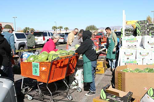 Brooke Curley Photo/ Gila Valley Central: Farmer's market attendees braved the brisk coolness Wednesday morning for the promise of produce.
