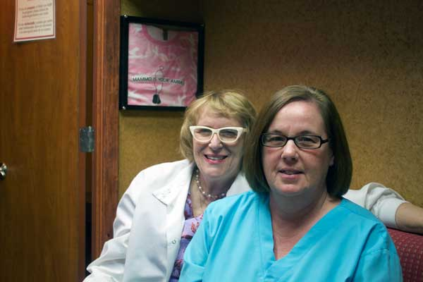 Jon Johnson Photo/Gila Valley Central: MOM technologist Kristina Krause, left, and employee Rise Ashcraft encourage women ages 30 and up to have an annual mammogram.