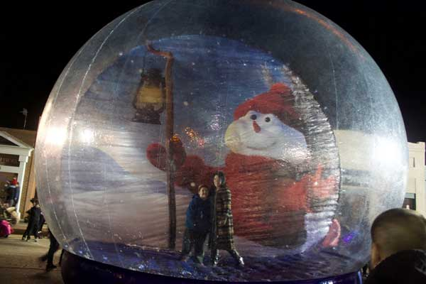 Jon Johnson Photo/Gila Valley Central: A couple gets their picture taken inside a giant snow globe.