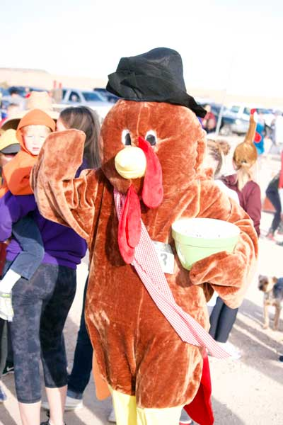 Jon Johnson Photo/Gila Valley Central: Stephanie Hoopes ran both races in her turkey mascot outfit and still had time to pass out candy to the children.