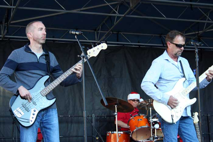 Photo By Walter Mares: Clifton Town Manager Ian McGaughey, right, jams on the bass.