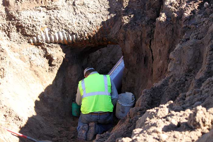 Jon Johnson Photo/Gila Valley Central: A Safford Utilities employee works on the reclaimed water pipeline.