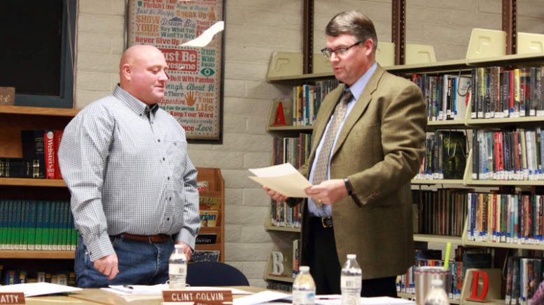 Eric Burk Photo/Gila Valley Central: Superintendent Rickert swears in newly elected school board member Clint Colvin.