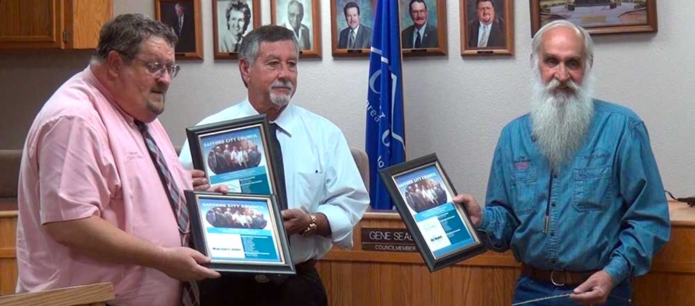 Jon Johnson Photo/Gila Valley Central: Outgoing council members, from left, Mayor Chris Gibbs, Ken Malloque and Jim Howes, display their plaques given in honor of their service.