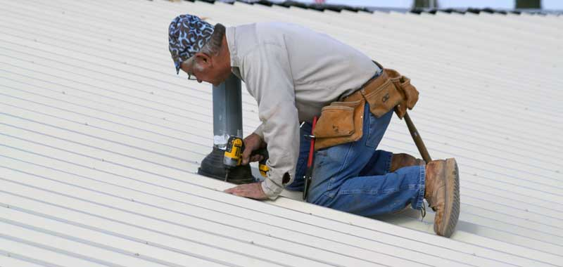 Jon Johnson Photo/Gila Valley Central: Rich Bishop Makes Sure The Covering  Is Properly Installed.
