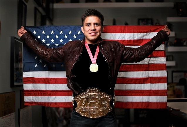 Image result for cejudo with gold medal and ufc belt