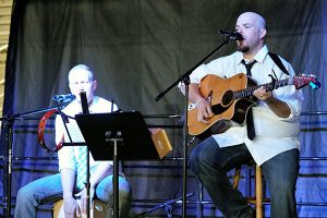 Jon Johnson File Photo/Gila Valley Central: Matthew Player, left, and Jace Hughes play a set at the Pioneer Days festival in July. Their band, PB&H also played the grand opening of Mike's Place on Saturday.