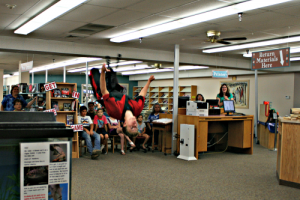 Brooke Curley Photo/ Gila Valley Central: Caden Jones performs a high back flip in the center of the Safford Library