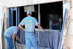 Jon Johnson Photo/Gila Valley Central: Workers from EA Glass repair the damaged windows.