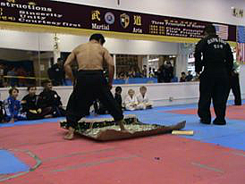 Contributed photo by: Alissa Stockton/ Grand Master Kim Walking on glass during the Black Belt Award cerimony and demonstration