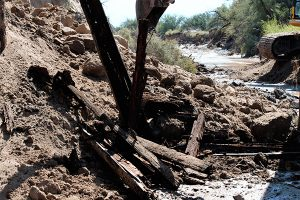 Jon Johnson Photo/Gila Valley Central: Water eroded the eastern cliff side of the Matthewsville Wash and washed out the train bridge.