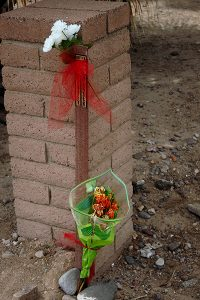 Jon Johnson Photo/Gila Valley Central: Flowers adorn an area where a motorcyclist crashed and died.