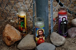 Jon Johnson Photo/Gila Valley Central: A memorial of candles and flowers has been set where Silver Glenn Rivera crashed his motorcycle and died.