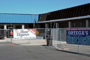 Jon Johnson Photo/Gila Valley Central: While a chain link fence keeps the public safe, businesses at the shopping center are still open during the construction.