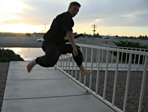 Photo: Brooke Curley/ Gila Valley Central.net: Chad Jones performs a high kick before the black belt ceremony.