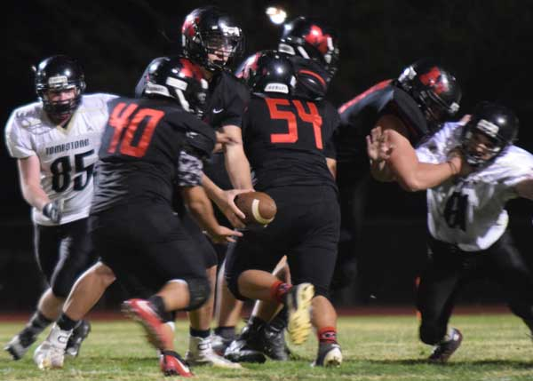 Photo By Raymundo Frasquillo: Isaiah Aguinaga (40) moves up to get a handoff from quarterback Kyle Swan during Morenci's home win over Tombstone. Aguinaga scored the Wildcats' touchdown in overtime en route to a 27-26 victory.