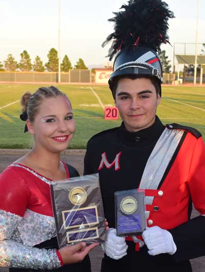 Photo By Raymundo Frasquillo: Morenci Pride Band senior color guard member Jessica Walls, left, and drum major Rey Placencio proudly display their honors.