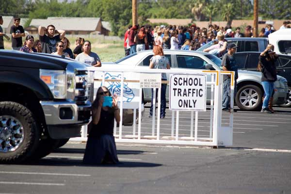 Jon Johnson Photo/Gila Valley Central: Students wait outside school Monday during a bomb threat. The threat was deemed a hoax and police arrested Timothy Diaz, 17, Tuesday.