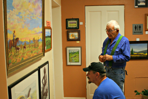 Brooke Curley Photo/ Gila Valley Central: Left to Right: Leon Noel and Wes Bryce viewing the gallery.