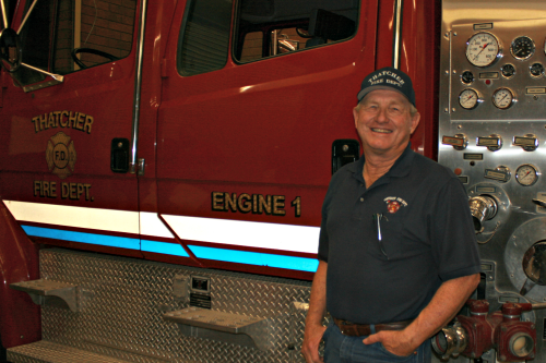 Brooke Curley Photo/ Gila Valley Central: Thatcher Fire Chief Mike Payne stands beside one of the fire trucks in the Thatcher fire station.