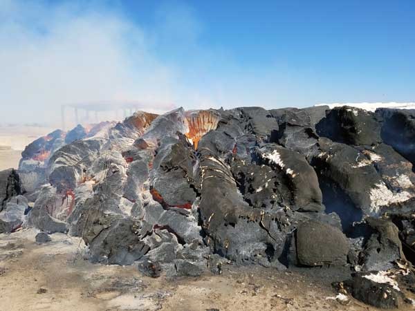 Contributed Photo/Courtesy Adam Hoopes: Bales of cotton turn into coals.