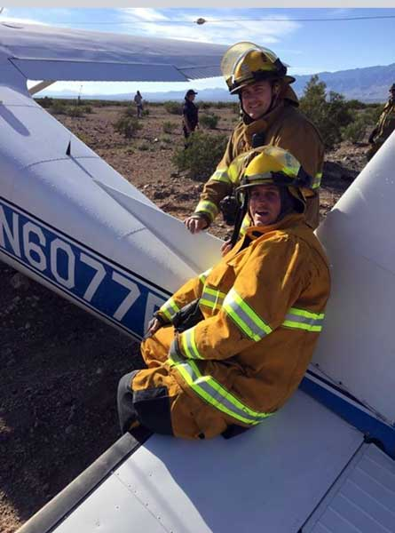 Photo by Safford Fire Department: Safford Fire Department members take a load off at the crash site.