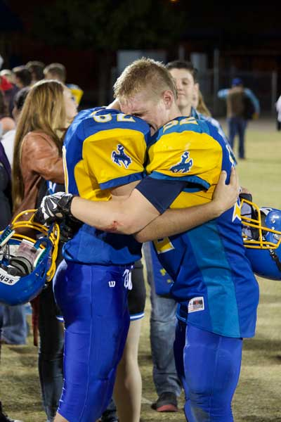 Jon Johnson Photo/Gila Valley Central: Ethan Claridge, left, and Hadley Schmidt console each other after their final high school football game was over.