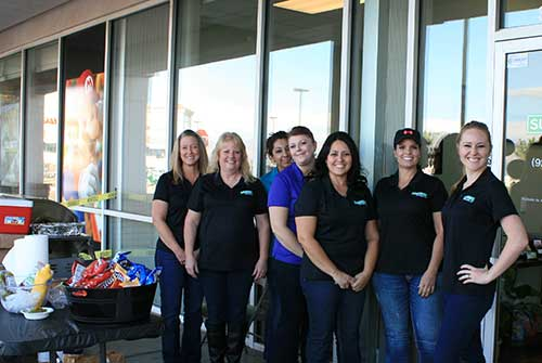 Brooke Curley Photo/ Gila Valley Central: From Left to Right: Alex Giampietro, Lori Travalera, Sharon Dominguez, Tiffancy Faunce, Veronica Montes, Ellen Cooper, Tommy Fenn stand beside the grill that has been working away all day for a good cause.