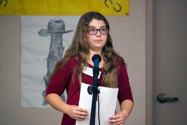 Jon Johnson Photo/Gila Valley Central: Poetry winner Sydney Haralson finishes her poem.