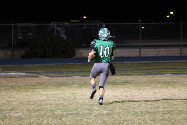 L. Scott Bennett Photo: Thatcher's Aric Peterson (10) heads off to the end zone without a defender in sight.