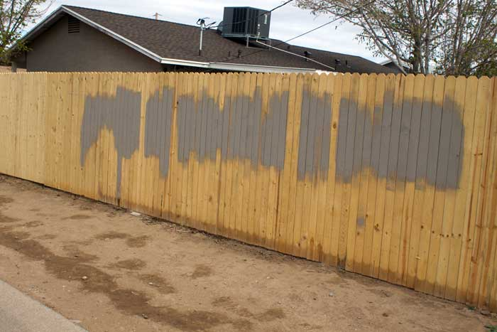 Jon Johnson Photo/Gila Valley Central: The resident of this tagged fence on 20th Street had already covered the graffiti by Monday morning.
