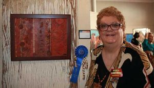 Brooke curley Photo/ Gila Valley Central: Linda Foute is the first place winner of the Color of Copper Art Gala art competition.