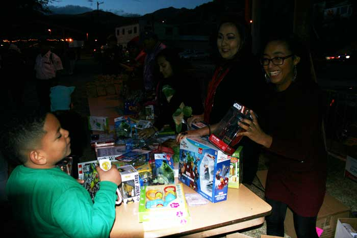 Photo By Walter Mares: Children, such as this one, were delighted as they received toys and bags of candy at the American Legion Post 28 Christmas Eve party. The annual event was again held at Al Fernandez Park.