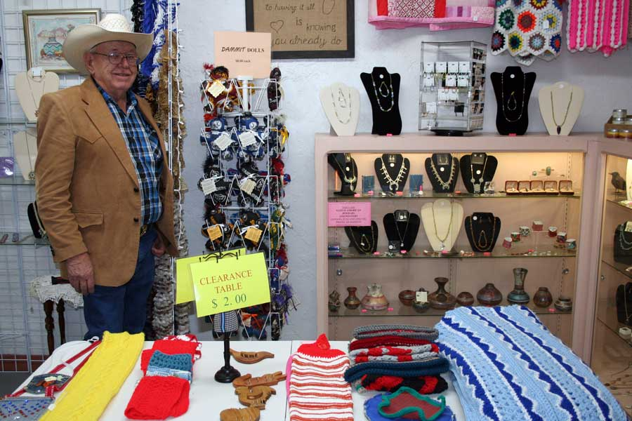 Photo By Walter Mares: Doug Barlow displays a crafts and gifts nook in his Rock-A-Buy rock shop in Duncan. The necklaces were made by Native Americans from the Navajo, Apache and Zuni tribes. The crafts in the foreground and at right include locally made fragrant soaps and candles