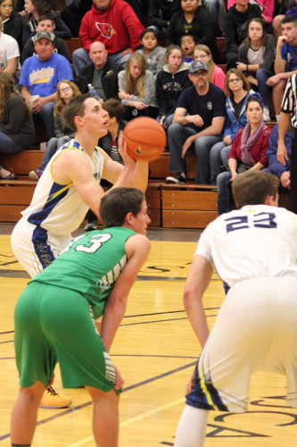 Eric Burk Photo/Gila Valley Central: Jarrett Kartchner takes a free throw shot. Thatcher committed numerous fouls in the game.