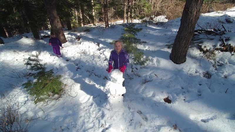 Jon Johnson Photo/Gila Valley Central: Ambrosia Johnson makes a snowman during an outing to Mount Graham on Dec. 26.