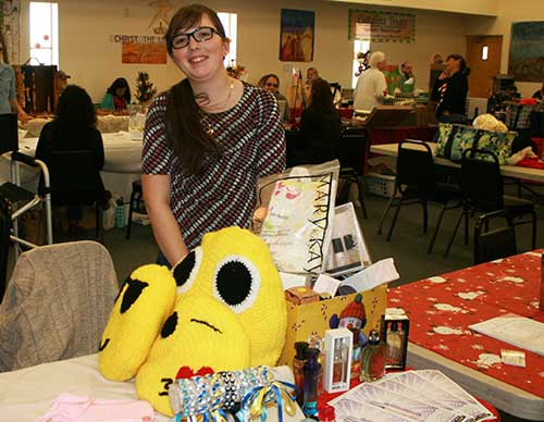 Marie Barney was one of the younger vendors , and was selling her handmade tab-bracelets along with handmade pillows.