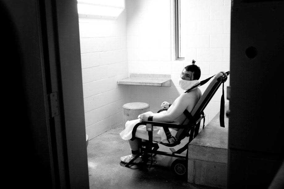 Photo By Jenn Ackerman: A mentally challenged inmate in Kentucky is placed in a restraint chair with a spit hood for his own safety.