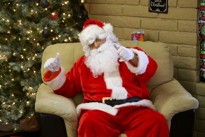 Jon Johnson Photo/Gila Valley Central: Santa Claus (AKA Robert Porter) was on had to pose for pictures.