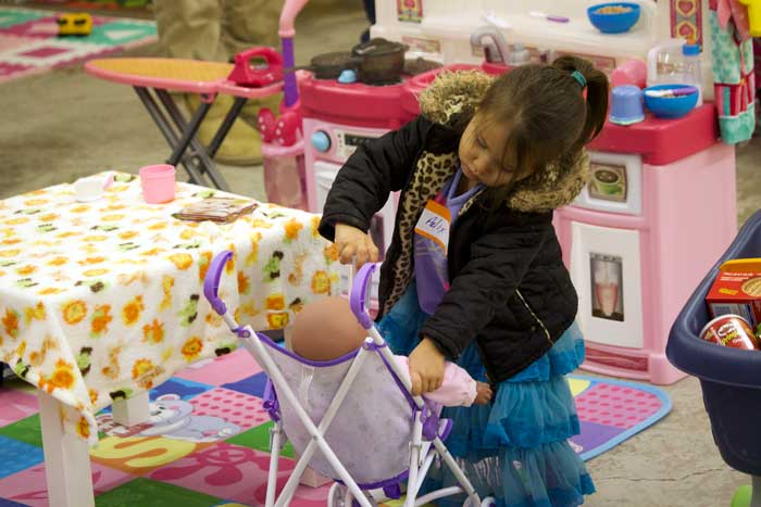 Jon Johnson Photo/Gila Valley Central: This little girl enjoys playing mommy during the event.
