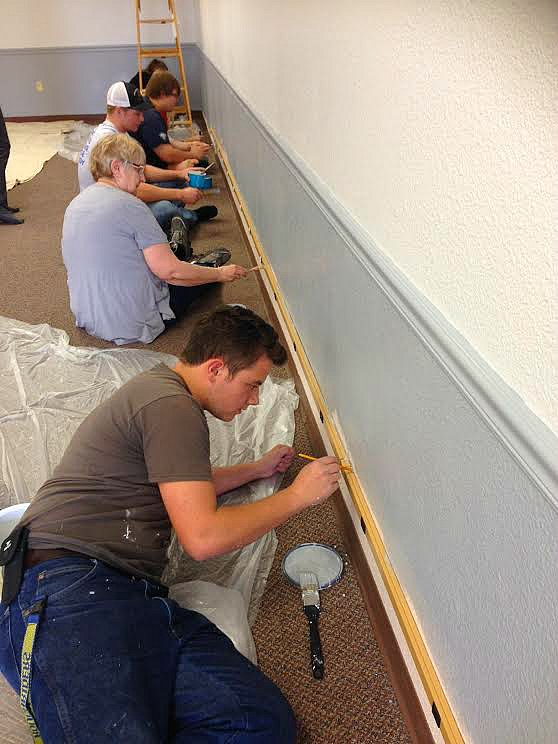 Contributed Photo Courtesy of Retha Russell: A small group of volunteers worked together to brighten and clean for Talley's project in the library.