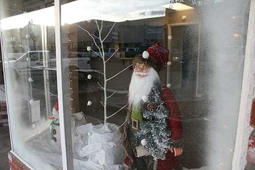 Brooke Curley Photo/ Gila Valley Central: Santa looks out of the window from his winter wonderland of the Souder Miller and Associates, winner of the small window category.