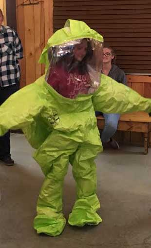 Contributed photo courtesy of Dan Anger: Leona Shelton tries on a chemical safety suit.