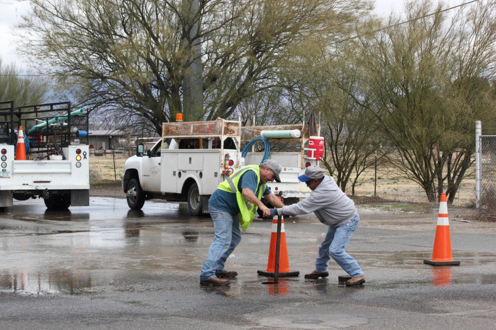 Eric Burk Photo/Gila Valley Central: Safford Utilities workers turn off the water to stop the flooding.
